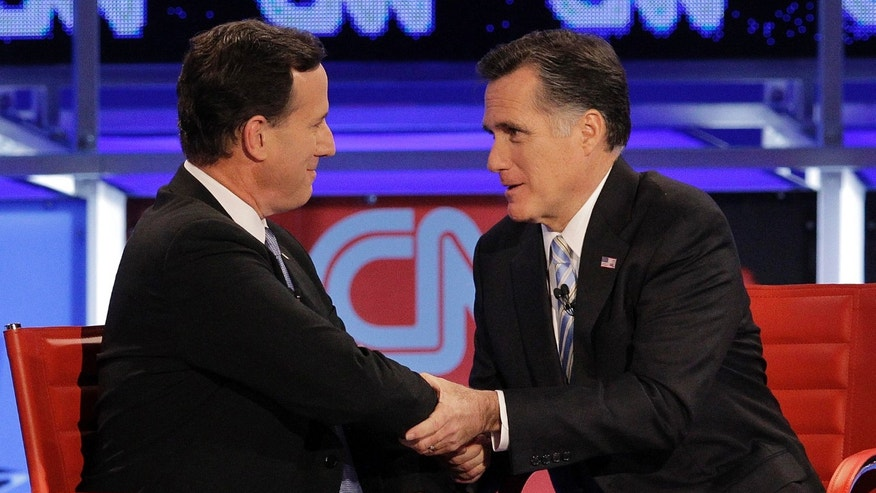 FILE: Republican presidential candidate and former Massachusetts Gov. Mitt Romney, right, talks with  ex-candidate, former Pennsylvania Sen. Rick Santorum, left, after a presidential debate in Arizona.