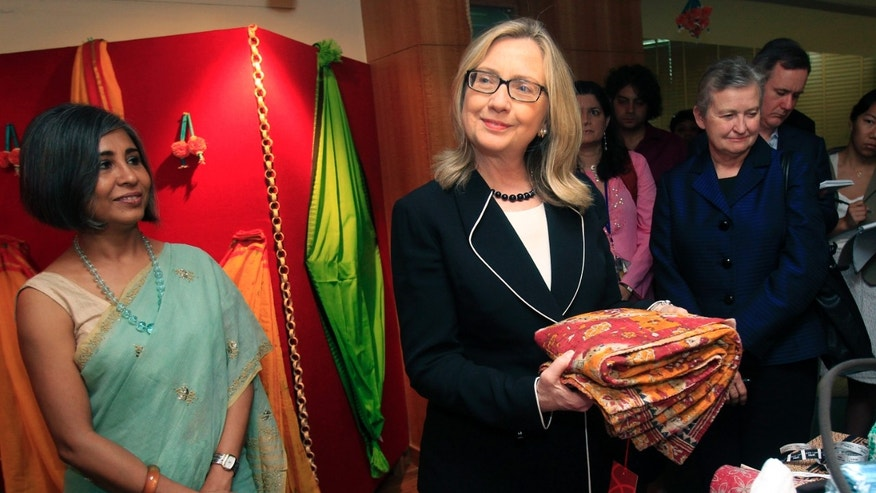 May 6, 2012: U.S. Secretary of State Hillary Clinton holds a sari during an Anti-Human Trafficking event in Kolkata, India.