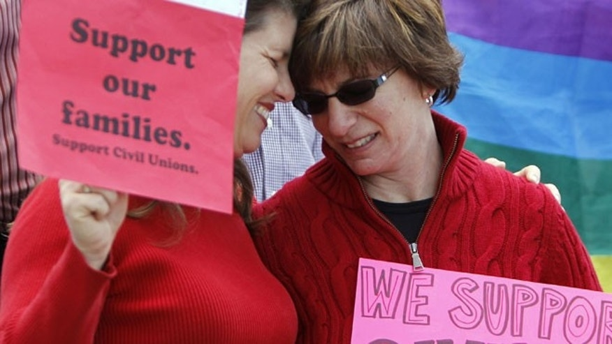 May 8, 2012: Partners Anna Simon, left, and Fran Simon embrace at a rally in support of Civil Unions at the Capitol in Denver.