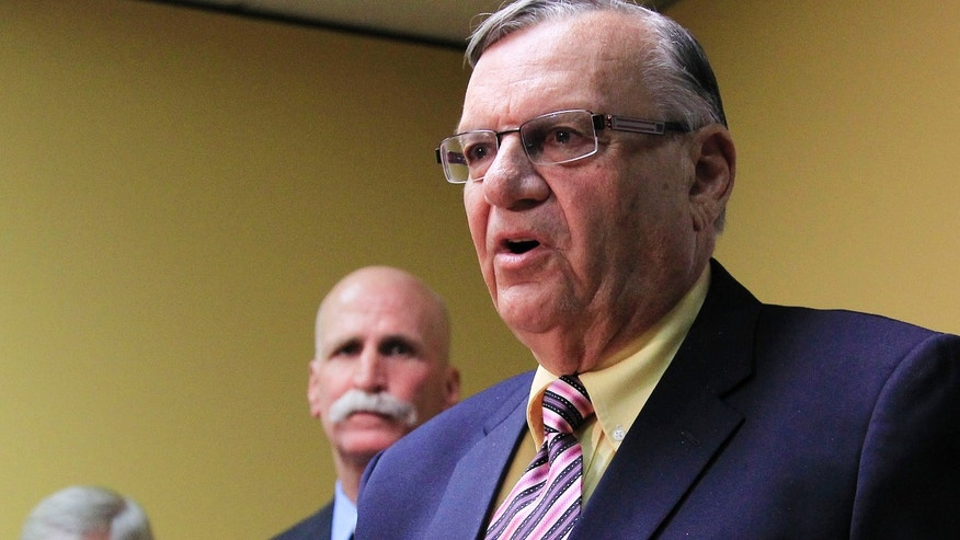 April 3, 2012: Maricopa County Sheriff Joe Arpaio answers questions during a news conference in Phoenix.