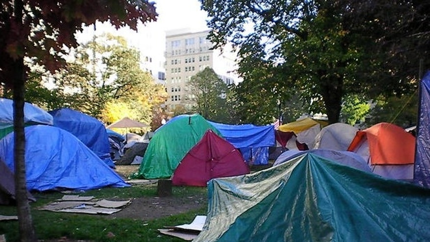 File: 2012: The now-shuttered Occupy DC encampment at McPherson Square, just blocks from the White House in Washington.