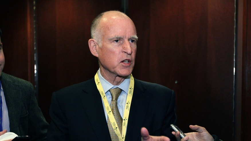 Feb. 26, 2012: California Gov. Jerry Brown speaks with reporters during the National Governors Association winter meeting in Washington.