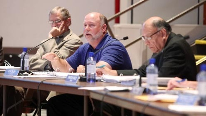 May 15, 2012: Hutchinson City Council member Bob Bush, center, speaks during a hearing on a new anti-discrimination ordinance in Hutchinson, Kan. (The Hutchinson News/Travis Morisse)