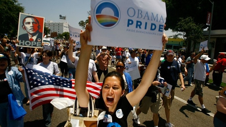 Gay pride participants support Barack Obama at the 38th annual LA Pride Parade June 8, 2008 in West Hollywood, California. (Photo by David McNew/Getty Images)