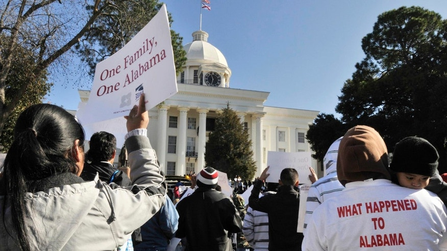 Rally against House Bill 56 at the Alabama Capitol and Children's March to the Governor's Mansion on Saturday, Dec. 17, 2011, in Montgomery, Ala. (AP Photo/Montgomery Advertiser, Lloyd Gallman)
