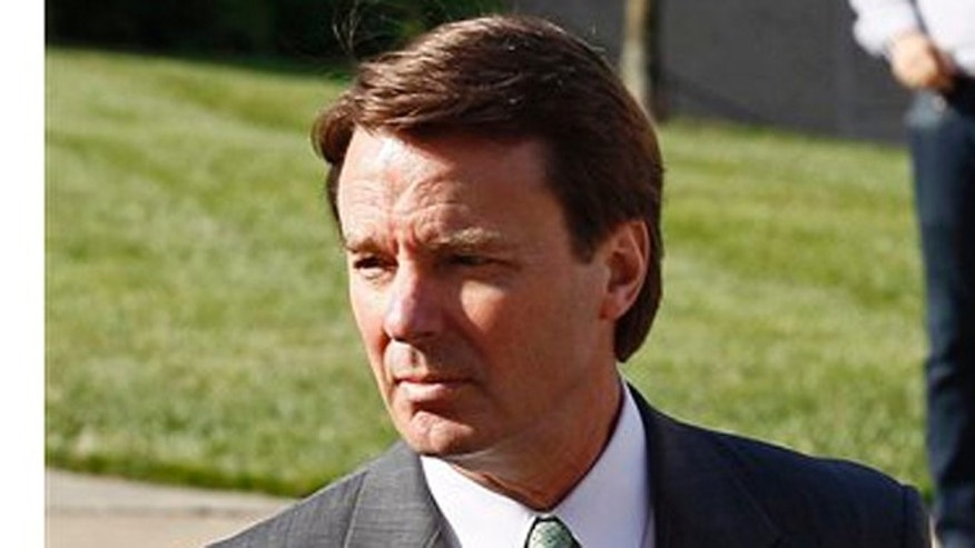 Former presidential candidate and Sen. John Edwards, left, arrives at a federal courthouse in Greensboro, N.C., Thursday, May 17, 2012. Edwards has pleaded not guilty to six counts related to campaign finance violations over nearly $1 million from two wealthy donors used to help hide the Democrat's pregnant mistress as he sought the White House in 2008. (AP Photo/Gerry Broome)