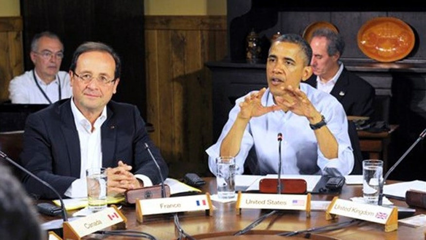 Saturday May 19, 2012: French President Francois Hollande, left, listens as President Obama speaks at G8 Summit at Camp David, Md.