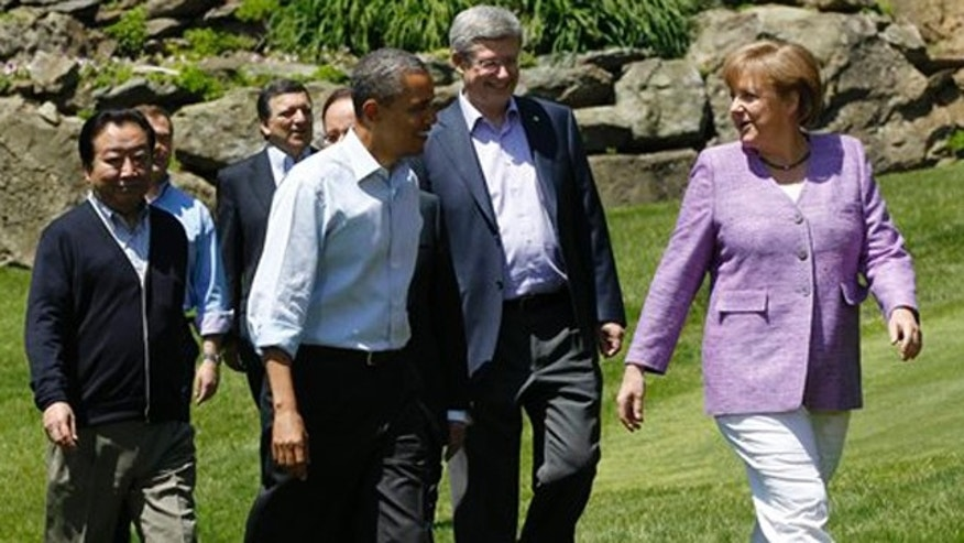 May 19, 2012: From left, Japanese Prime Minister Yoshihiko Noda, Russian Prime Minister Dmitry Medvedev, President of the European Commission Jose Manuel Barroso, President Barack Obama, Canadian Prime Minister Stephen Harper and German Chancellor Angela Merkel make their way to a photo opportunity at the G-8 Summit Saturday, at Camp David, Md.