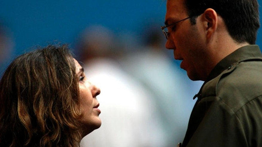Mariela Castro speaks with her brother Alejandro Castro,June 19, 2007. (AP Photo/Ismael Francisco, Prensa Latina)
