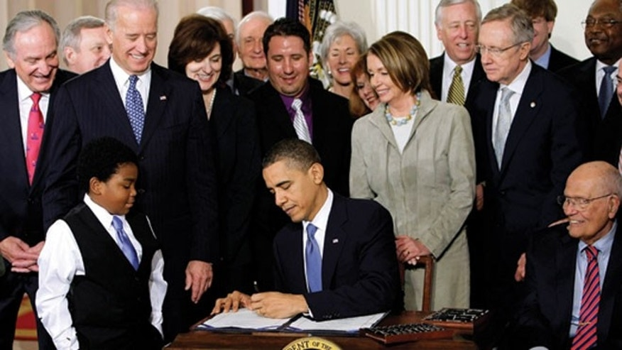 March 23, 2010: President Obama signs the health care bill in the White House in Washington.