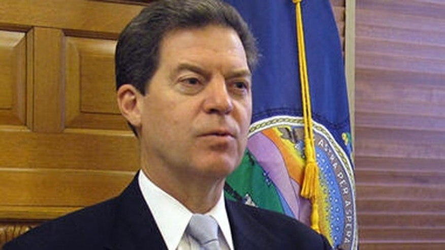 This undated photo shows Kansas Gov. Sam Brownback at a press conference.