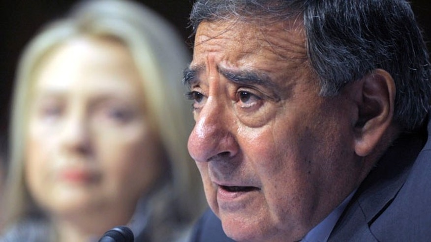 May 23, 2012: Defense Secretary Leon Panetta testifies on Capitol Hill in Washington, as Secretary of State Hillary Clinton looks on.