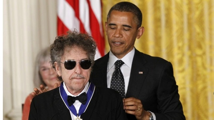 May 29, 2012: President Barack Obama presents rock legend Bob Dylan with a Medal of Freedom during a ceremony at the White House in Washington.