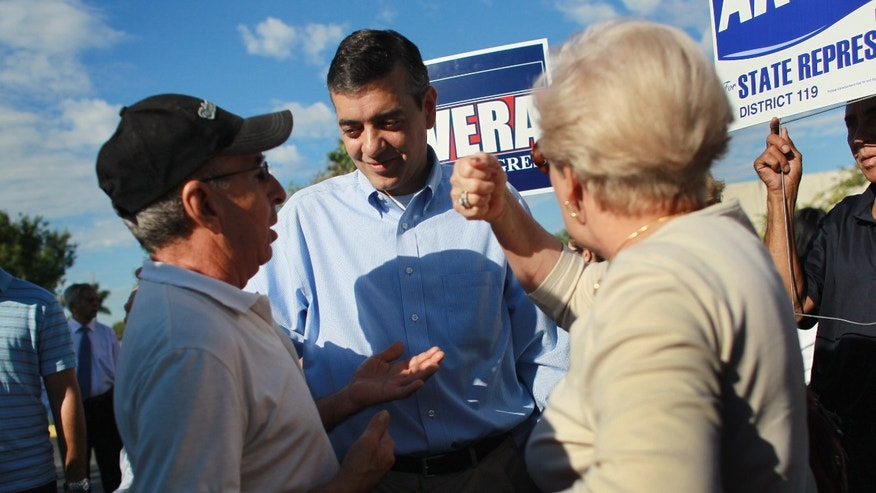 MIAMI - OCTOBER 20:  Republican Congressional candidate David Rivera (C) is greeted by supporters as he campaigns at an early voting site on October 20, 2010 in Miami, Florida. Rivera is running against Democrat Joe Garcia for the 25th congressional district.  (Photo by Joe Raedle/Getty Images)