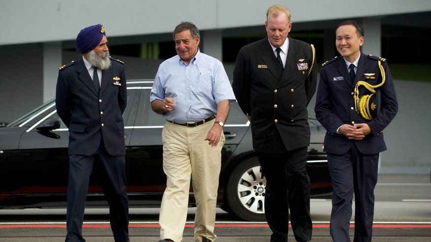 June 3, 2012: U.S. Secretary of Defense Leon Panetta, second from left, walks with Commander Air Power Generation Command Col. Sarbjit Singh, left, Defense and Naval Attache for Singapore Capt. John Wood, second from right, and Singapore Defense Attache to the U.S. Brig Gen. Chee Wee Tan before departing Paya Lebar Airfeild, Singapore.