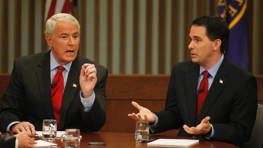 May 31, 2012: Republican Wisconsin Gov. Scott Walker, right, and Democratic challenger Tom Barrett participate in a televised debate in Milwaukee.