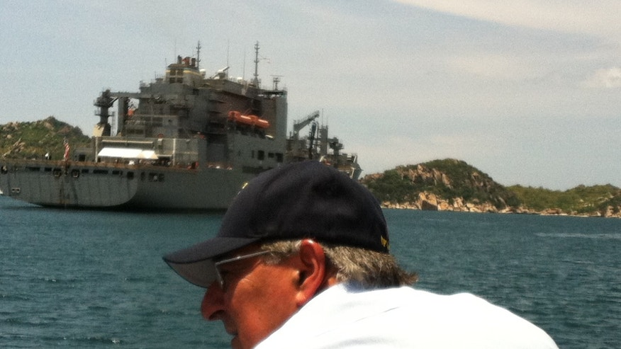 June 3, 2012: Defense Secretary Panetta approaches USNS Byrd in Cam Ranh Bay.