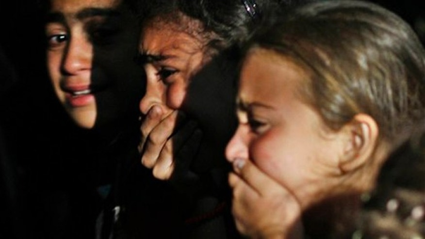 June 4, 2012: Relatives of a Free Syrian Army soldier killed during clashes with the regime gunmen mourn at his funeral.