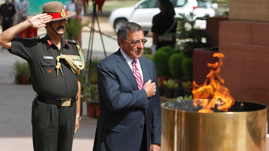 June 6, 2012: U.S. Defense Secretary Leon Panetta pays tribute at the India Gate war memorial monument, in New Delhi, India. Panetta is urging leaders of India to play a more robust role in Afghanistan, as U.S. tensions with Pakistan, India's arch-rival, continue to churn.