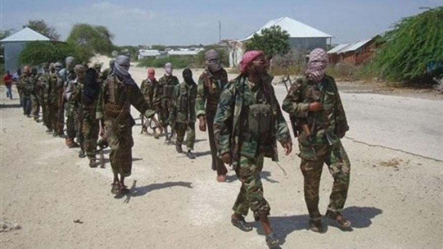 March 5, 2012: Members of Somalia's al- Shabab militant group patrol on foot on the outskirts of Mogadishu.