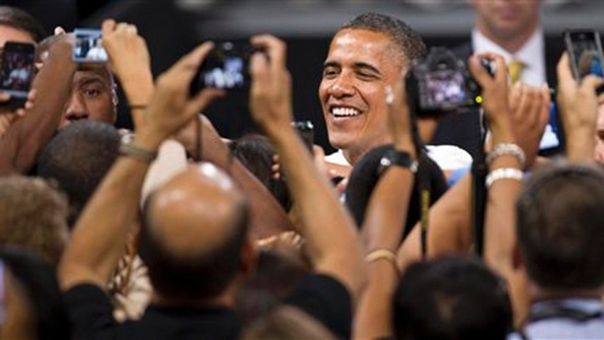 Thursday, June 7, 2012: President Barack Obama greets supporters shortly after giving a speech at the University of Nevada, Las Vegas.