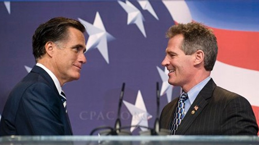 FILE - Feb. 18, 2010: Mitt Romney, left, and Sen. Scott Brown, R- Mass., at the Conservative Political Action Conference, in Washington.