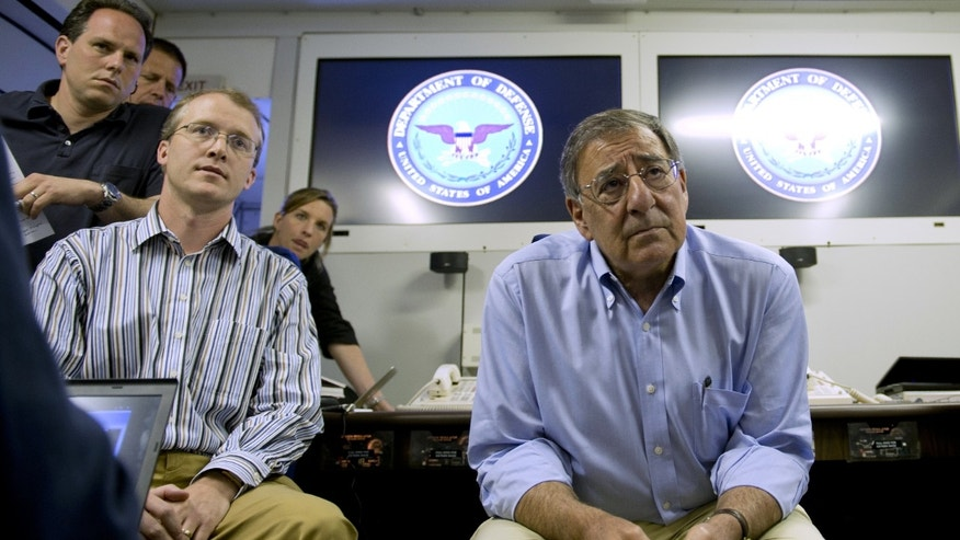 May 31, 2012: Secretary of Defense Leon Panetta listens to a question during media briefing onboard his plane enroute to Singapore from Honolulu, Hawaii.