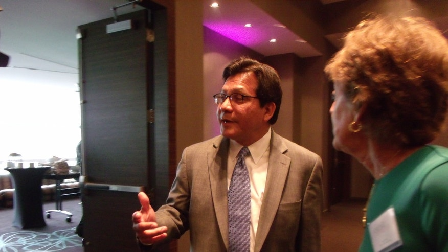 Former U.S. Attorney General Alberto Gonzales at the Southeast summit on immigration on June 11, 2012.