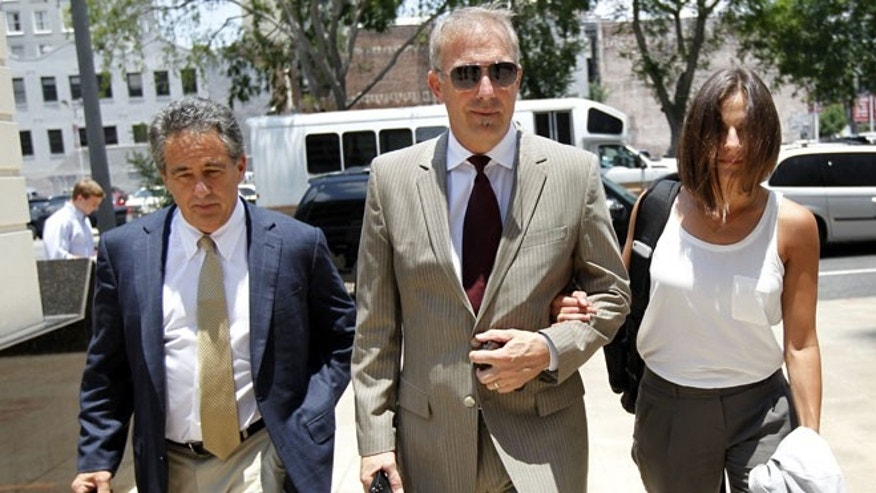 June 14, 2012: Kevin Costner, center, arrives at Federal Court in New Orleans.