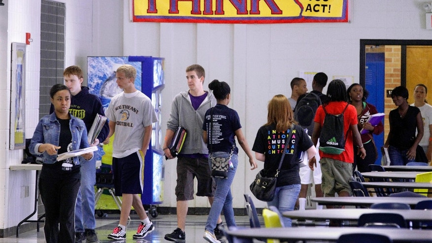 May 11, 2012: In this photo, Springfield Southeast High School students are seen walking through the hallway while changing classes in Springfield, Ill.