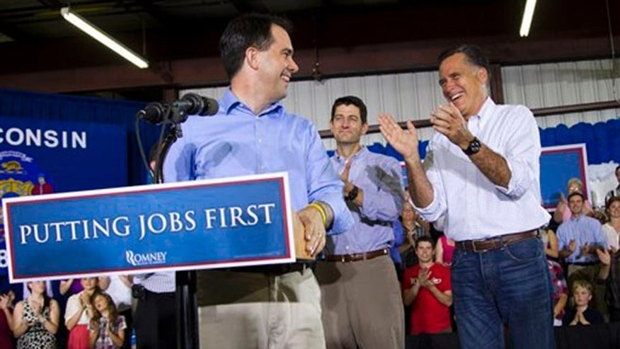 June 18, 2012: Mitt Romney, right, is introduced by Wisconsin Gov. Scott Walker, left, in Janesville, Wis.