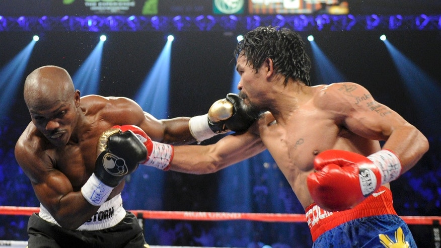 June 9, 2012: Timothy Bradley, from Palm Springs, Calif., left, trades blows with Manny Pacquiao, from the Philippines, in their WBO world welterweight title fight in Las Vegas. Bradley won the fight by split decision.