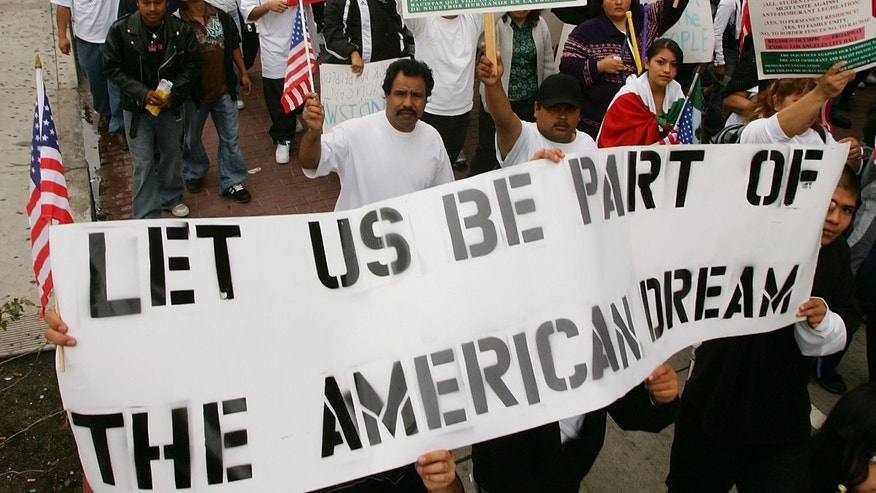 LOS ANGELES, CA - APRIL 15:  Students and supporters march to call for amnesty for illegal immigrants on April 15, 2006 in Los Angeles, California. The 3,000 people who marched through downtown to City Hall particularly oppose House bill HR 4437 by Rep. F. James Sensenbrenner, R-Wisconsin that would increase penalties for immigrant smuggling, beef up penalties for undocumented immigrants who re-enter the United States, and require employers to report Social Security numbers to the Department of Homeland Security. The march is dedicated to Ontario, California student Anthony Soltero, 14, who committed suicide on March 30 after a school administrator allegedly told him he would be fined and jailed for participating in a student walkout in support of undocumented immigrants rights on March 28.  (Photo by David McNew/Getty Images)