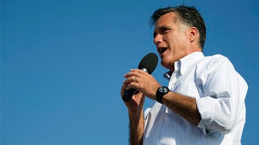 June 19, 2012: Mitt Romney gestures during a campaign stop at Holland State Park in Holland, Mich.