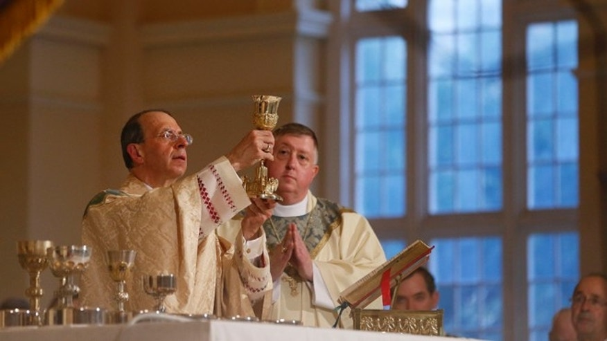 "June 21, 2012: Baltimore Archbishop William Lori raises a chalice during a liturgy to kick off the two-week ""Fortnight For Freedom"" campaign."