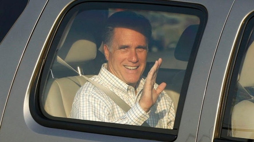 June 22, 2012: Mitt Romney waves as he arrives at the Utah Olympic Park for a private dinner during a donor conference in Park City, Utah.