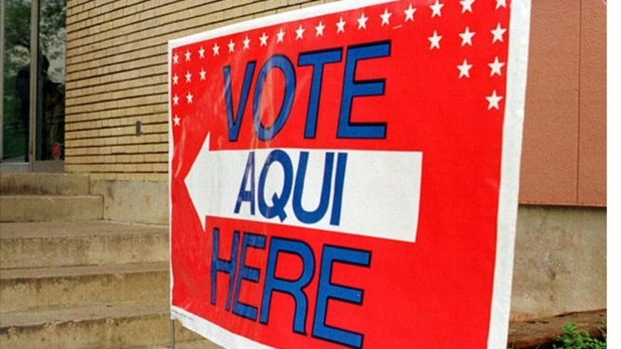 FILE: Polling station sign in English and Spanish, Austin, Texas.