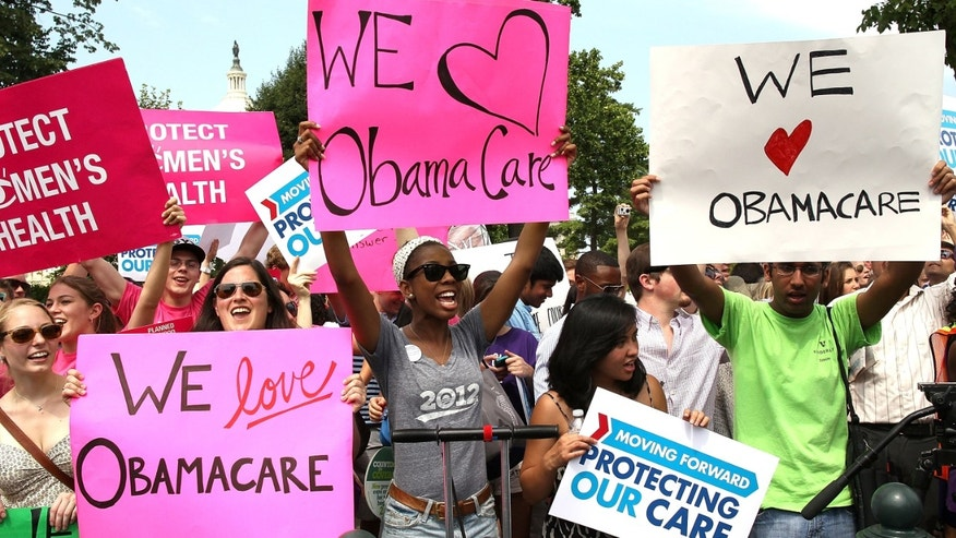 WASHINGTON, DC - JUNE 28: Obamacare supporters react to the  U.S. Supreme Court decision to uphold President Obama's health care law, on June 28, 2012 in Washington, DC. Today the high court upheld the whole healthcare law of the Obama Administration.  (Photo by Mark Wilson/Getty Images)
