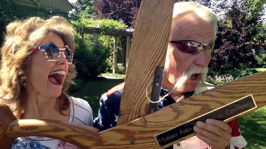 July 4, 2012: Dan Snarr, the mayor of the Salt Lake City suburb of Murray, jokes with wife, April, in Murray, Utah, after a parade in which he put all 18 inches of his handlebar mustache up for a vote. He has been growing it for 31 months but says he will shave if a majority of residents voted thumbs-down during the annual parade.