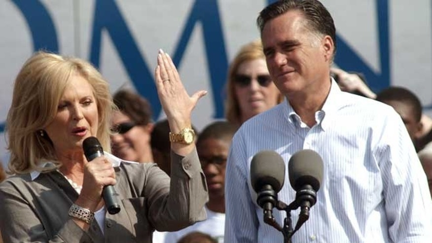 "June 19, 2012: Ann Romney uses her hand as a Michigan ""map"" while making a speech as her husband, Republican presidential candidate, former Massachusetts Gov. Mitt Romney, right, listens during a campaign stop at Bavarian Inn Lodge in Frankenmuth, Mich."