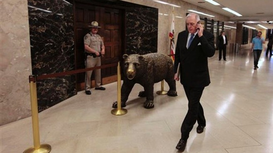 July 6, 2012: Dan Richard, chair of the California High-Speed Rail Authority, paces outside the Governor's office as he talks on his cell phone at the Capitol in Sacramento, Calif.
