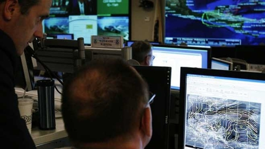 In this September 24, 2010 file photo U.S. Department of Homeland Security analysts work at the National Cybersecurity & Communications Integration Center (NCCIC) located just outside Washington in Arlington, Virginia.