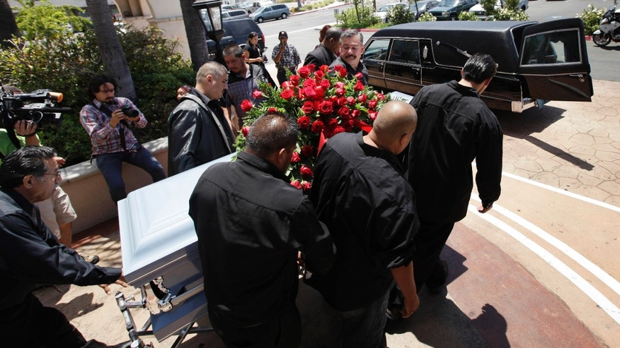 This June 19,2010 file photo shows relatives and friends of Anastasio Hernandez carrying a casket out of a church after funeral services in San Diego.