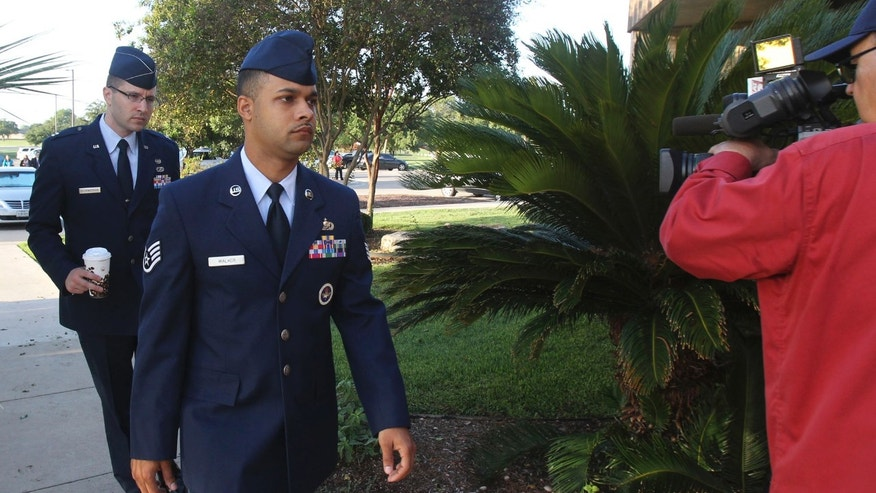 July 20, 2012: Air Force Staff Sgt. Luis Walker, left foreground,  arrives for the fourth day of his trial at Lackland Air Force Base in San Antonio, Texas.