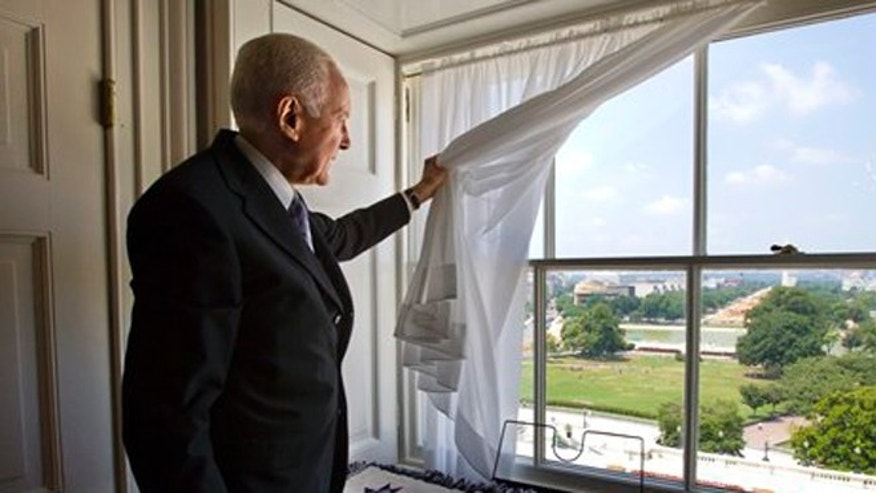 FILE: July 16, 2012: Sen. Orrin Hatch, R-Utah, looks out of a window in a small private office at the Capitol in Washington.