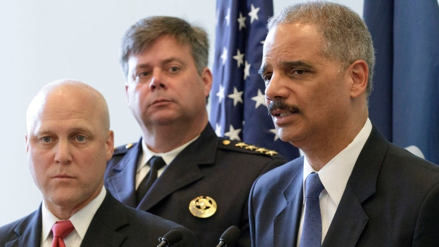 July 24, 2012: U.S. Attorney General Eric Holder speaks next to New Orleans Mayor Mitch Landrieu, far left, and Police Superintendent Ronal Serpas about the details of a federal consent decree from the U.S. Department of Justice that will be used to institute reforms in the New Orleans Police Department inside the historic Gallier Hall.
