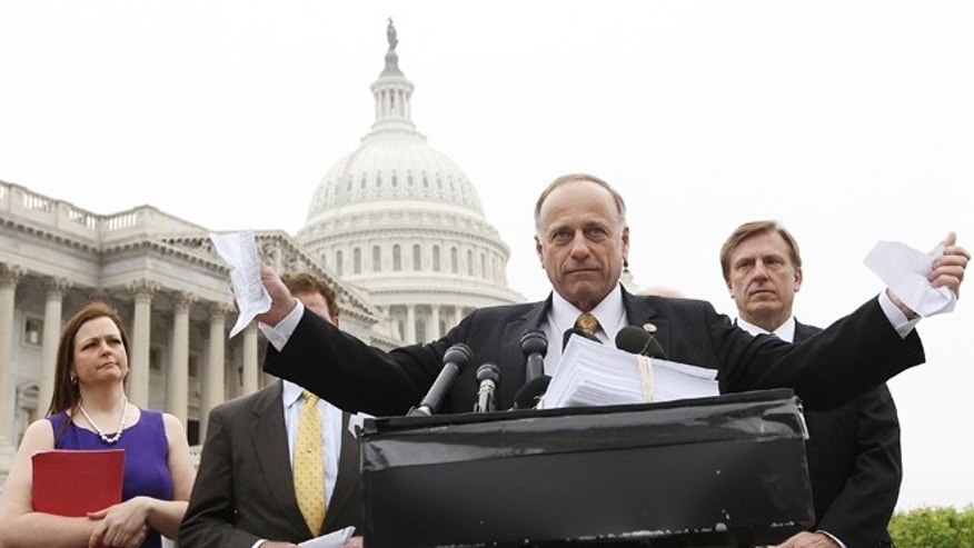 WASHINGTON, DC - MARCH 21:  U.S. Rep. Steve King (R-IA) tears a page from the national health care bill during a press conference at the U.S. Capitol March 21, 2012 in Washington, DC. Republican members from the House of Representatives gatherered to speak out against the health care bill which is the topic of a case before the Supreme Court next week.  (Photo by Win McNamee/Getty Images)
