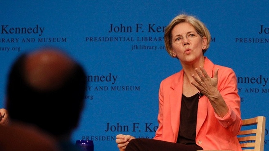 July 17, 2012: Massachusetts Democratic Senate candidate Elizabeth Warren talks during a forum at the John F. Kennedy Presidential Library and Museum in Boston.