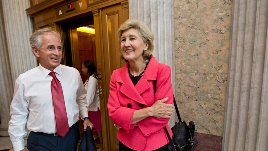 July 17, 2012:Sen. Bob Corker, R-Tenn., left, and Sen. Kay Bailey Hutchison, R-Texas, arrive for a Republican strategy luncheon with former Vice President Dick Cheney, at the Capitol in Washington.
