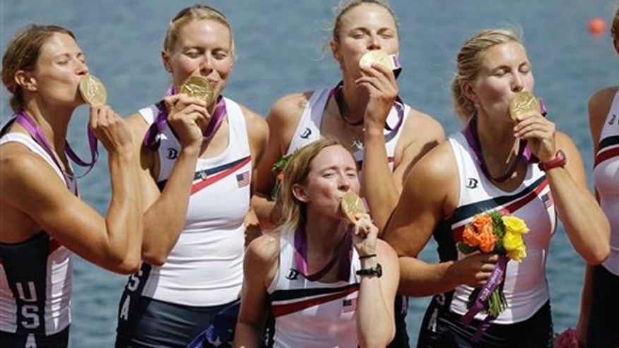 Aug. 2, 2012: U.S. rowers from the women's eight team kiss the gold medals they won in the 2012 Olympic Games in London, England.
